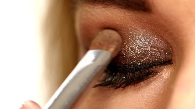 Perfect makeup. Beauty fashion. Eyelashes. Cosmetic Eyeshadow. close up. Slow motion Eye makeup woman applying eyeshadow powder. Beautiful woman face. Perfect makeup. Beauty fashion. Eyelashes. Cosmetic Eyeshadow. close up. Slow motion eyeshadow stock videos & royalty-free footage