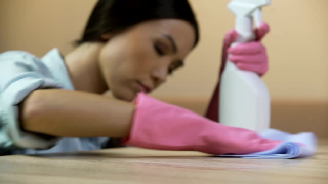 Perfectionist woman makes sure house furniture is completely clean from stains video