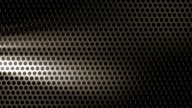 Perforated black sheet metal with volumetric light video