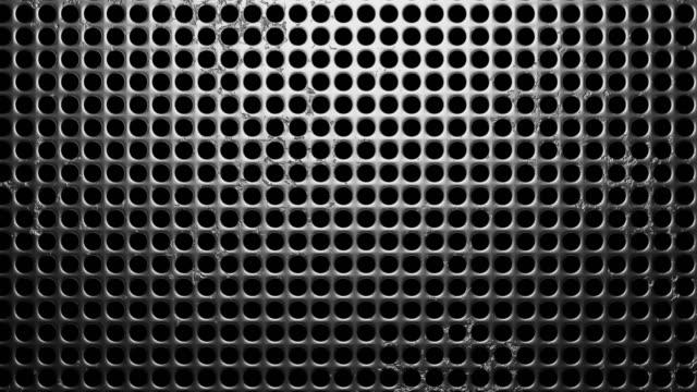 Geperforeerd metaal op zwarte achtergrond video