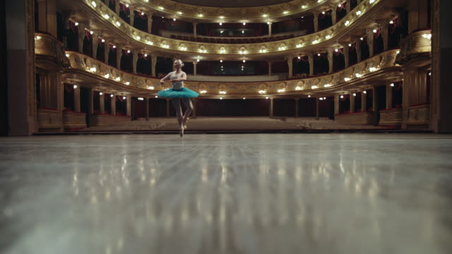 performance on the theater stage. beautiful ballerina. - paczka sukienka filmów i materiałów b-roll