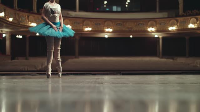 performance on the theater stage. schöne ballerina. - ballettschuh stock-videos und b-roll-filmmaterial