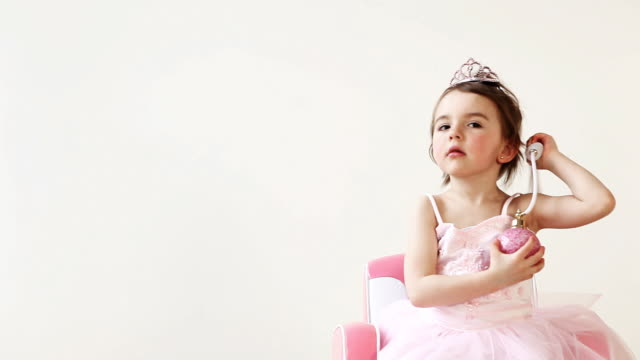 Perfume Princess Little girl playing with perfume in her princess dress. princess stock videos & royalty-free footage