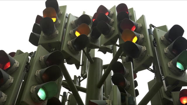 perplexing traffic lights - segnale per macchine e pedoni video stock e b–roll