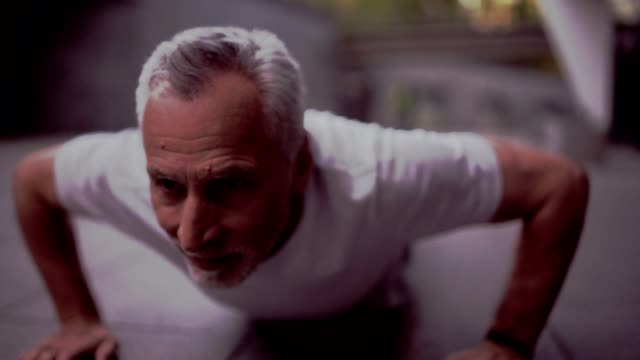 Persevering aged man doing push ups outdoors Dont give up. Confident senior man doing press ups and enjoying sport exercises while training push ups stock videos & royalty-free footage