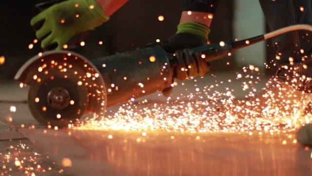 Person cutting metal with an angle grinder