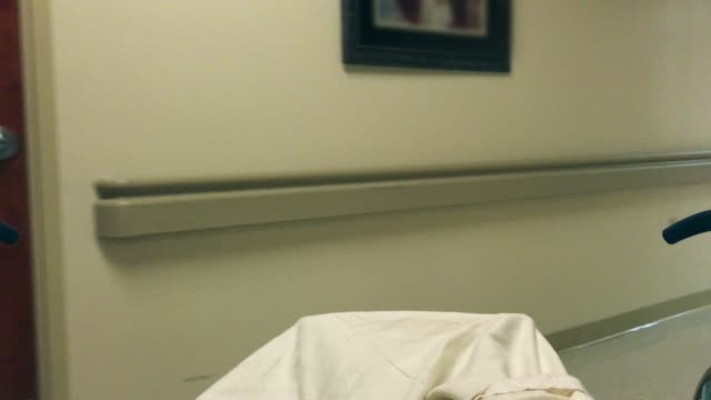 Person feet while transported in a hospital bed inside hopital video
