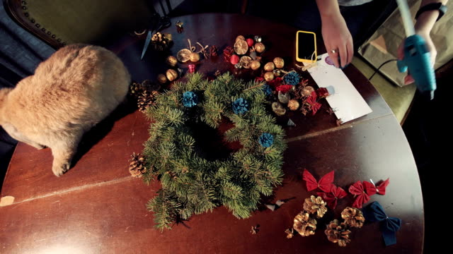 Person laying out natural ingredients for a wreath video