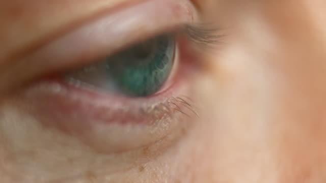 ECU Person opening a blue eye video