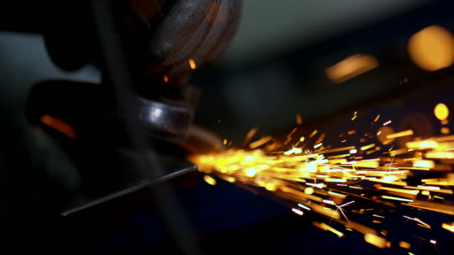SLO MO Person polishing metal with an angle grinder video
