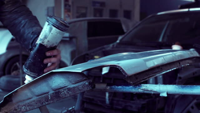 Person preparing car for painting video