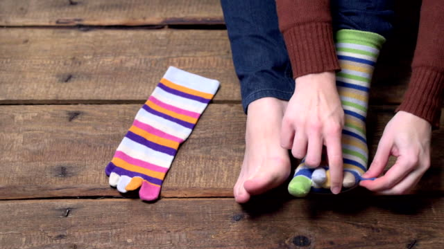 person putting on socks - calzino video stock e b–roll