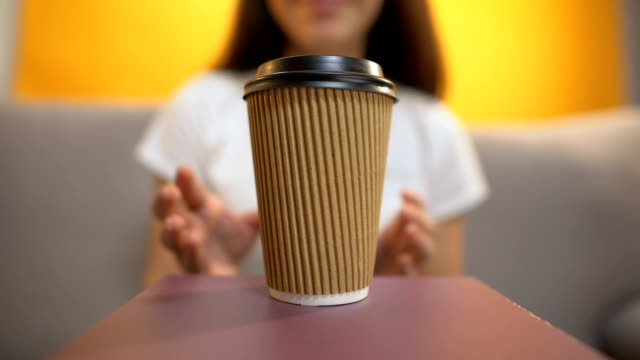 Person serving coffee to girl, caffeine addiction, morning energy booster