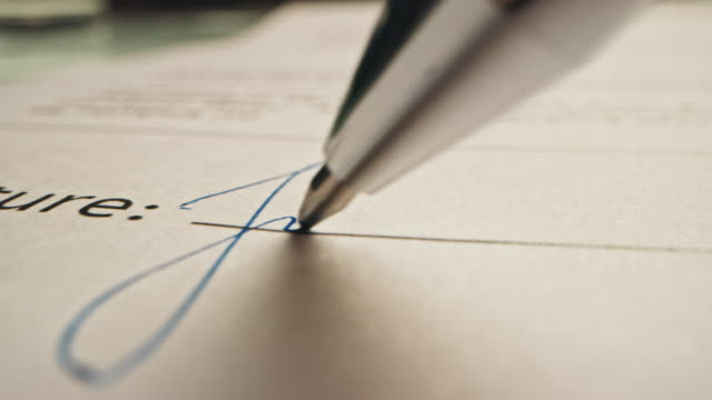 Person Signing Important Document. Camera Following Tip of the Pen as it Signs Crucial Business Contract. Mock-up