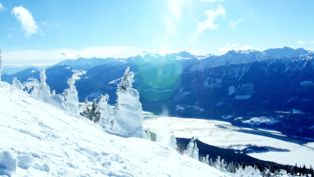 person snowboarding on snowy mountain - canada travel stock videos and b-roll footage