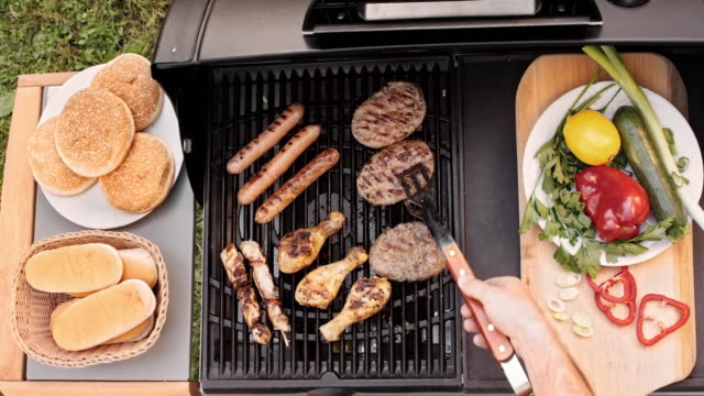 TIME LAPSE Person turning meat on the grill video