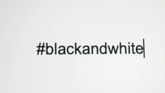 """A Person Types """"#blackandwhite"""" on Their Computer Screen A Person Types """"#blackandwhite"""" on Their Computer Screen civil rights stock videos & royalty-free footage"""