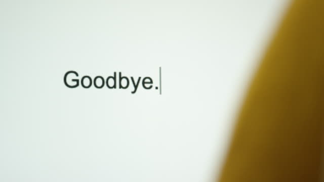 """A Person Types """"Goodbye"""" on Their Computer Screen A Person Types """"Goodbye"""" on Their Computer Screen relationship breakup stock videos & royalty-free footage"""