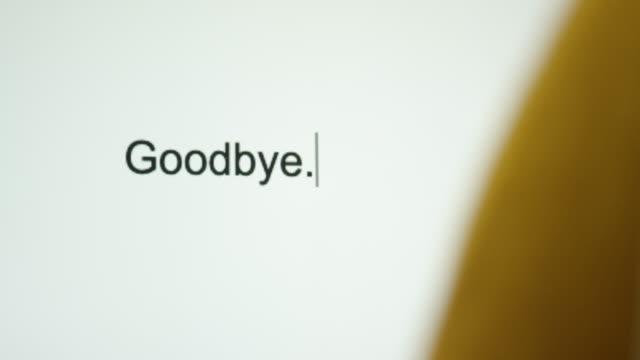 """vídeos de stock e filmes b-roll de a person types """"goodbye"""" on their computer screen - separação"""