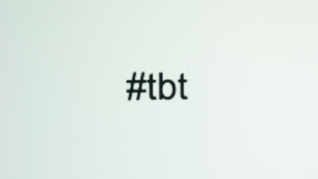 "a person types ""#tbt"" (throwback thursday) on their computer screen - tiktok стоковые видео и кадры b-roll"
