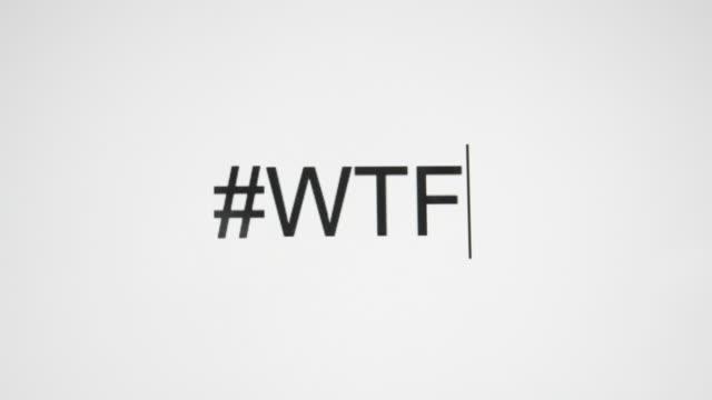 """stockvideo's en b-roll-footage met een persoon typen """"#wtf"""" op hun computer scherm - swearing"""