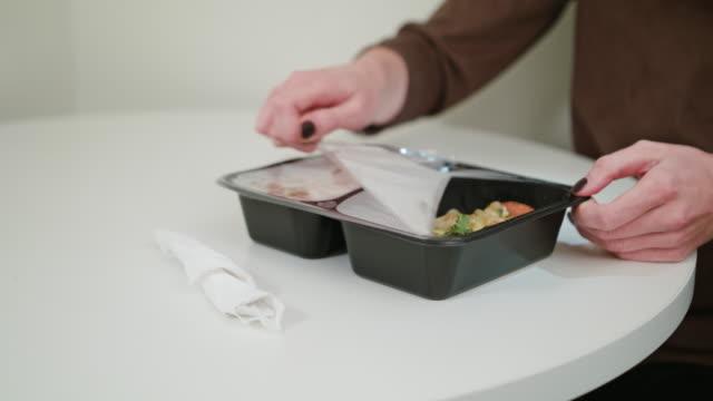 person unpacking junk food - oggetto creato dall'uomo video stock e b–roll