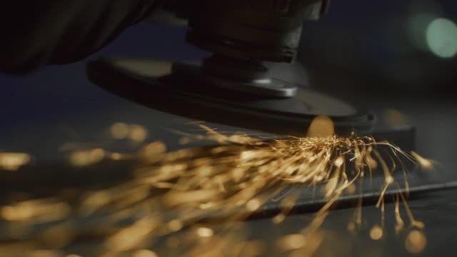 A Person Uses an Electric Angle Grinder to Smooth a Weld as Sparks Fly in a Workshop A Person Uses an Electric Angle Grinder to Smooth a Weld as Sparks Fly in a Workshop grinder industrial equipment stock videos & royalty-free footage