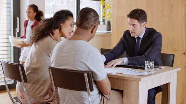 Personal banker visiting his clients at home