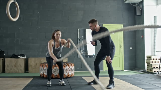 Personal Coach Controlling Woman during Rope Workout video