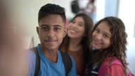 istock Personal perspective of a group of students taking a selfie 1285305124