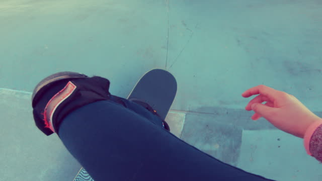 Personal Perspective of a Young Girl Skateboarding in Skateboard Park video