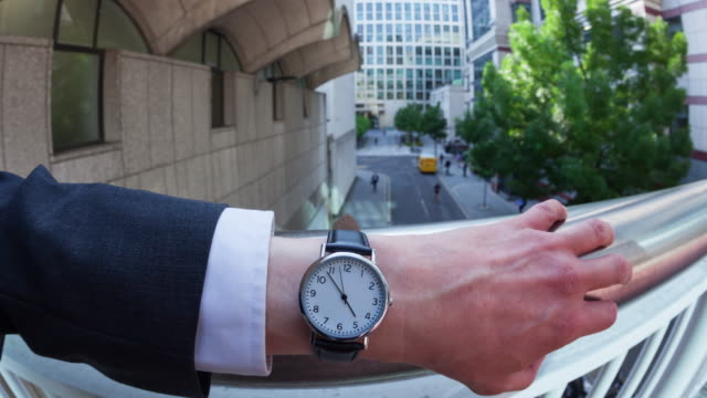 Personal perspective time-lapse of a businessman checking the time