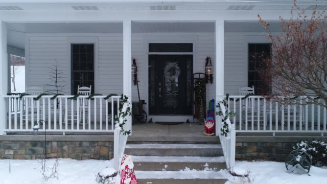 Personal Perspective Walking into House Decorated for Christmas A personal perspective slowly approaching the front door of a house and porch decorated for Christmas. front door stock videos & royalty-free footage