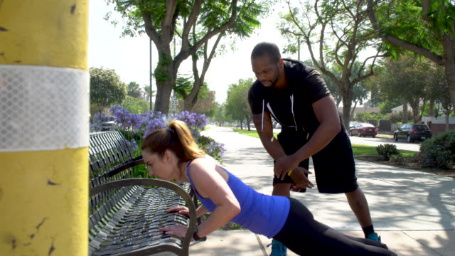 Personal Trainer Motivates Client Doing Pushups video