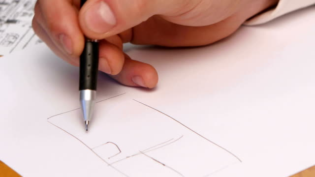 Person's Hand Drawing Plan On Blue Print. Close-up video
