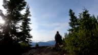 istock POV perspective of mountain biker descending trail 1167905126