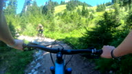 istock POV perspective view of biking along mountain slope, on trail 1266317640