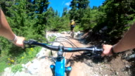 istock POV perspective view of biking along mountain slope, on trail 1266326304