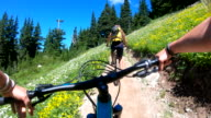 istock POV perspective view of biking along mountain slope, on trail 1266349590