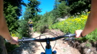 istock POV perspective view of biking along mountain slope, on trail 1266355190