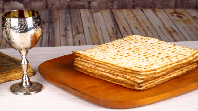Pesach matzo passover with wine and matzoh jewish passover bread Passover background with matzo video