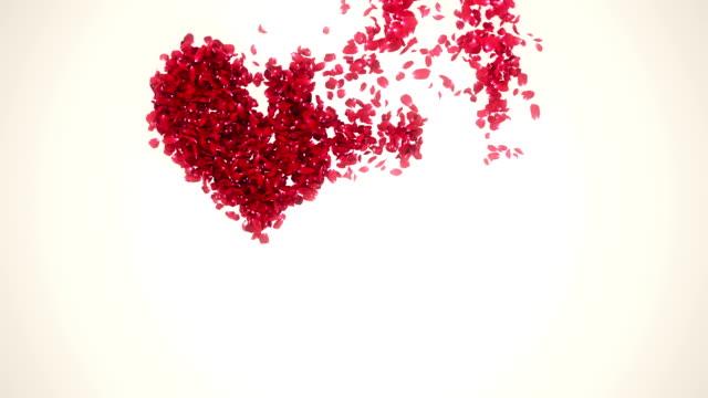 Petals in heart shape blowing away in wind