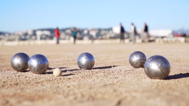 Petanque french game video slow motion HD Petanque is a famous french game with metalic balls and a little pig. provence alpes cote d'azur stock videos & royalty-free footage