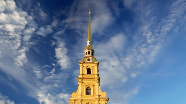 Peter and Paul Cathedral bells sound, tall golden spire against blue cloudy sky video