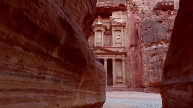 Petra. Petra - ancient city, view of Treasury from As Siq gorge. Jordan. treasury stock videos & royalty-free footage