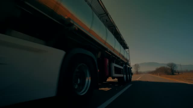 petrol truck driving and passing by - nave cisterna video stock e b–roll