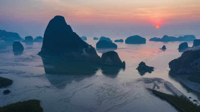 Phang-Nga Bay in sunrise time with Hyperlapse shot 4k Hyperlapse or drone Timelapse aerial view of Phang-Nga Bay landscape with beautiful fog flowing in sunrise time. Landmark travel destinations of southern Thailand. beauty in nature stock videos & royalty-free footage