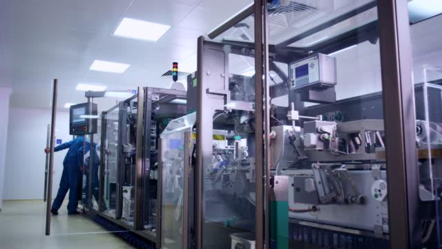 Pharmaceutical factory machine. Operator control pharmaceutical equipment video
