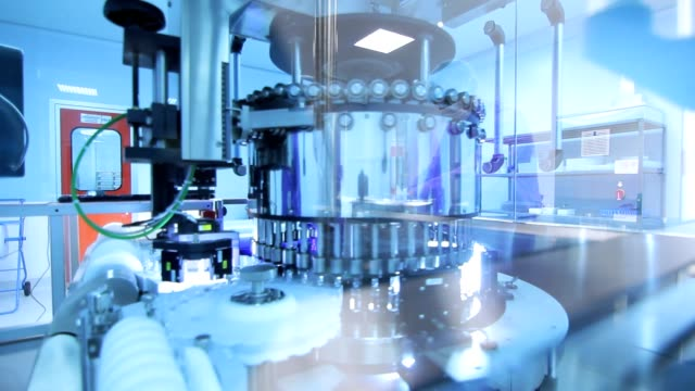 Pharmaceutical manufacturing line. Medical vials at production line