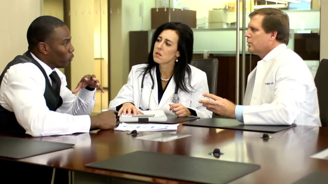 Pharmaceutical Representative Meets with Doctors video
